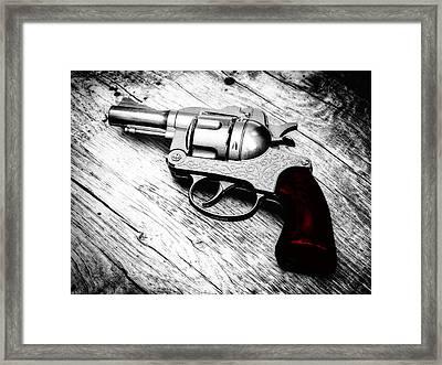 Revolver Framed Print by Wim Lanclus
