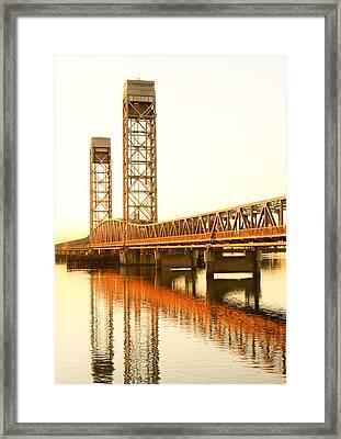 Rio Vista Bridge Sunrise Framed Print by Troy Montemayor