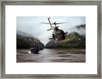 River Patrol Framed Print by Peter Chilelli
