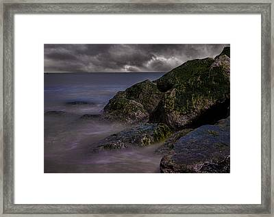 Rock Faces Framed Print by Martin Newman