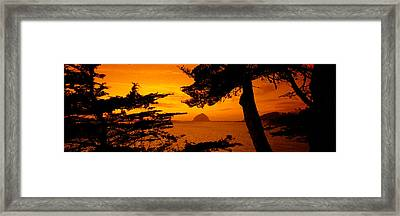 Rock In A Lake At Dusk, Morro Rock Framed Print by Panoramic Images