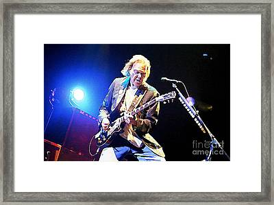 Rocking In The Free World Framed Print by John Malone