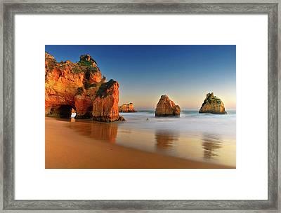 Rocks In Sea Framed Print by Juampiter