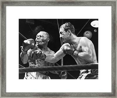 Rocky Marciano Landing A Punch Framed Print by Everett