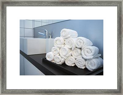 Rolled Towels Stacked In The Shape Of A Pyramid Framed Print by Larry Washburn
