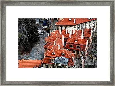 Roofs In Prague Framed Print by John Rizzuto