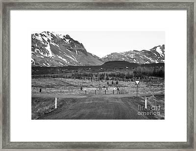 rough gravel road junction in rural Iceland Framed Print by Joe Fox