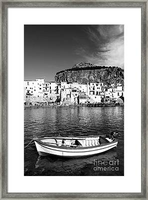 Rowboat Along An Idyllic Sicilian Village. Framed Print by Stefano Senise
