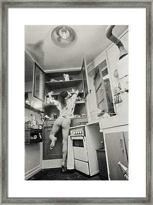 Running Through The Kitchen Framed Print by Philippe Taka