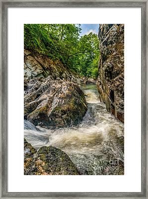 Rushing Waters  Framed Print by Adrian Evans