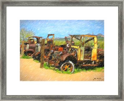 Rust And Trucks In Field Framed Print by John Farr