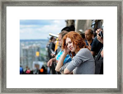 Sad Girl In The Crowd Framed Print by Evgeny Ivanov