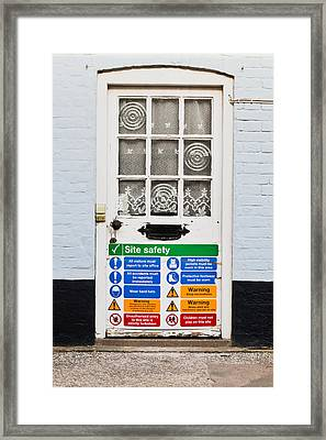 Safety Sign Framed Print by Tom Gowanlock