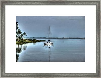 Sailboat Off Plash Framed Print by Michael Thomas
