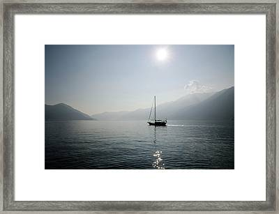 Sailing Boat In Alpine Lake Framed Print by Mats Silvan