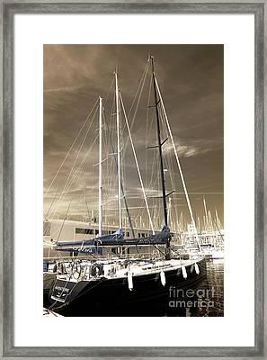 Sails Down Framed Print by John Rizzuto
