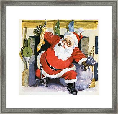 Santa Claus Emerging From The Fireplace On Christmas Eve Framed Print by American School