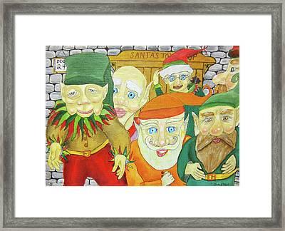 Santas Elves Framed Print by Gordon Wendling