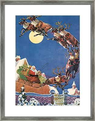 Santa's Sleigh And Reindeer Flying In The Night Sky On Christmas Eve Framed Print by American School