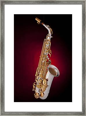 Saxophone On Red Spotlight Framed Print by M K  Miller