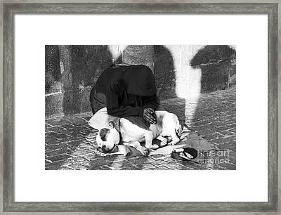 Say A Prayer In Prague Framed Print by John Rizzuto