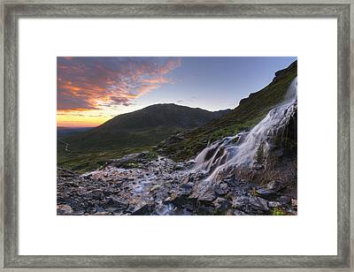 Scenic Sunset View Of A Waterfall Framed Print by Lucas Payne