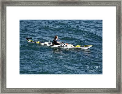 Sea Kayak Man Kayaking Off The Coast Of Dorset England Uk Framed Print by Andy Smy