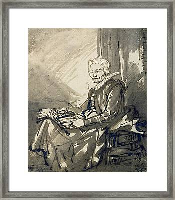 Seated Woman With An Open Book On Her Lap Framed Print by Rembrandt