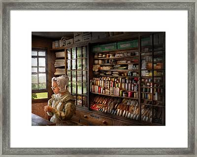 Sewing - Minding The Store  Framed Print by Mike Savad