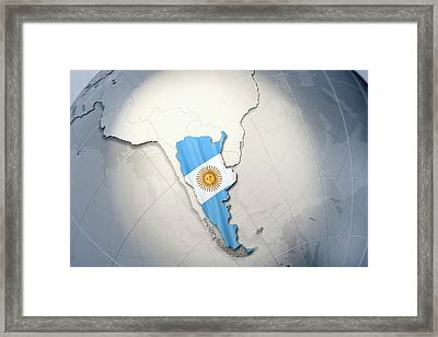 Shape And Ensign Of Argentina On A Globe Framed Print by Dieter Spannknebel