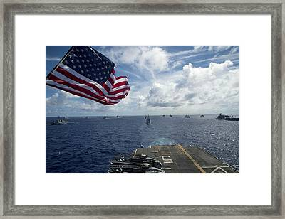 Ships Gather In Formation Aft Of The Amphibious Assault Ship Uss Peleliu  Framed Print by Celestial Images