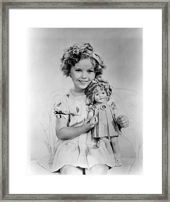 Shirley Temple With A Shirley Temple Framed Print by Everett