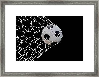 Shoot Soccer Ball In Goal Framed Print by Anek Suwannaphoom