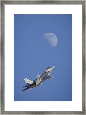 Shoot The Moon Framed Print by Adam Romanowicz