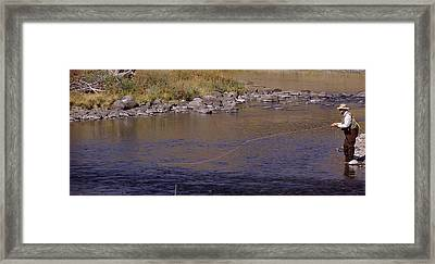 Side Profile Of A Man Fishing, Slough Framed Print by Panoramic Images