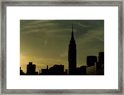 Silhouette Of Empire State Building Framed Print by Todd Gipstein