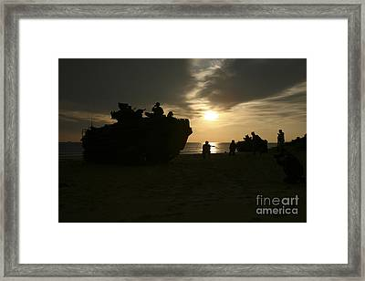 Silhouette Of Marines And An Amphibious Framed Print by Stocktrek Images