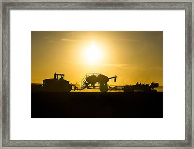 Sillhouette Of Tractors Planting Wheat Framed Print by Todd Klassy