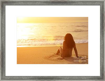 Sitting In The Sand Framed Print by Carlos Caetano