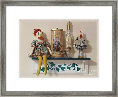 Sitting On The Shelf Framed Print by Charles Robinson