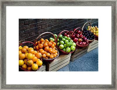 Six Baskets Of Assorted Fresh Fruit Framed Print by Todd Gipstein