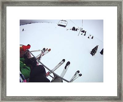 Skiers Sitting On Chairlift Framed Print by William Andrew