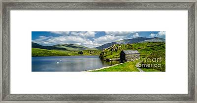 Skies Over Snowdon Framed Print by Adrian Evans
