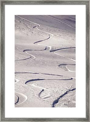 Skiing Tracks Framed Print by John Foxx