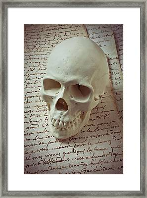 Skull On Old Letters Framed Print by Garry Gay