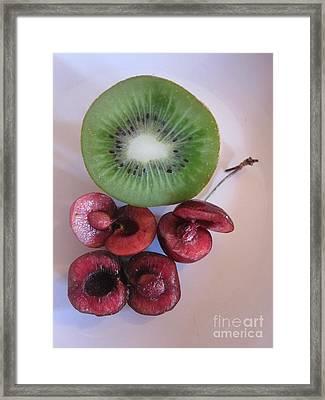 Sliced Cherries And Kiwi Framed Print by Funmi Adeshina
