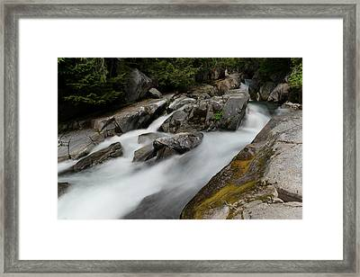 Sliding Through The Rocks Framed Print by Jeff Swan