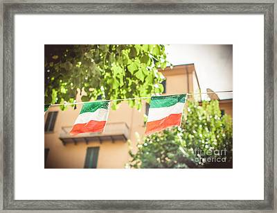 small Italian flags hanging by a thread Framed Print by Luca Lorenzelli