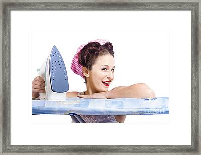 Smiling Housewife Doing Housework Laundry Duties Framed Print by Jorgo Photography - Wall Art Gallery