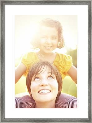 Smiling Mother Holding Daughter Framed Print by Gillham Studios